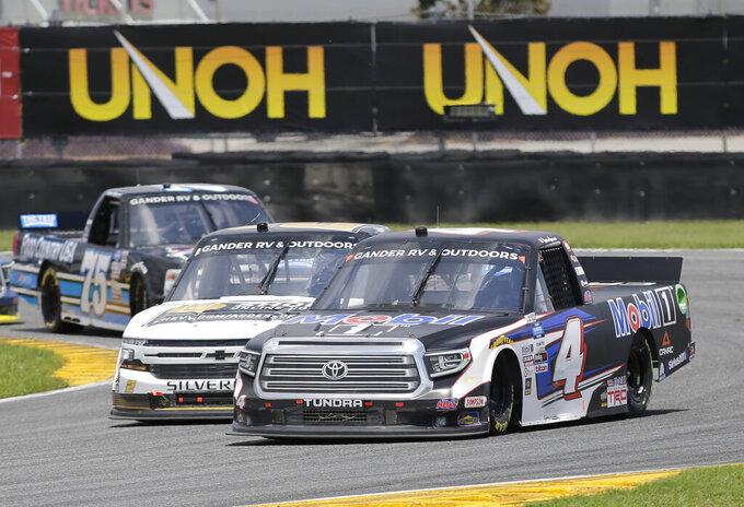 Raphael Lessard races on the road course during a NASCAR Truck Series auto race at Daytona International Speedway, Sunday, Aug. 16, 2020, in Daytona Beach, Fla. (AP Photo/Terry Renna)