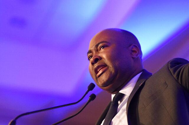In this Monday, Feb. 24, 2020 photo, Democratic Senate candidate Jaime Harrison, who is challenging U.S. Sen. Lindsey Graham, R-S.C., speaks at a South Carolina Democratic Party dinner in Charleston, S.C. (AP Photo/Meg Kinnard)
