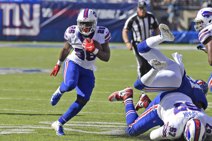 Buffalo Bills' Devin Singletary runs the ball during the second half of an NFL football game against the New York Giants, Sunday, Sept. 15, 2019, in East Rutherford, N.J. (AP Photo/Bill Kostroun)