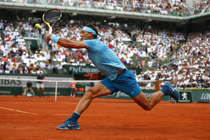 FILE - In this June 10, 2018, file photo, Spain's Rafael Nadal returns the ball to Austria's Dominic Thiem during the men's final match of the French Open tennis tournament at the Roland Garros stadium in Paris. (AP Photo/Thibault Camus, File)
