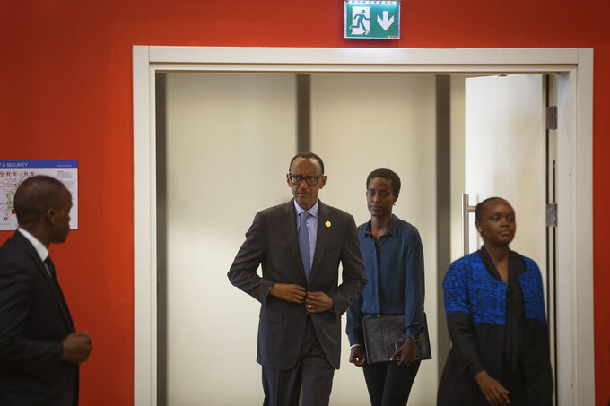 "FILE - In this Monday, April 8, 2019 file photo, Rwanda's President Paul Kagame, center, arrives for a press conference at a convention center in the capital Kigali, Rwanda. The new book ""Do Not Disturb"" by British author Michela Wrong questions why some in the international community continue to praise Rwandan President Paul Kagame despite repression in his central African country. (AP Photo/Ben Curtis, File)"