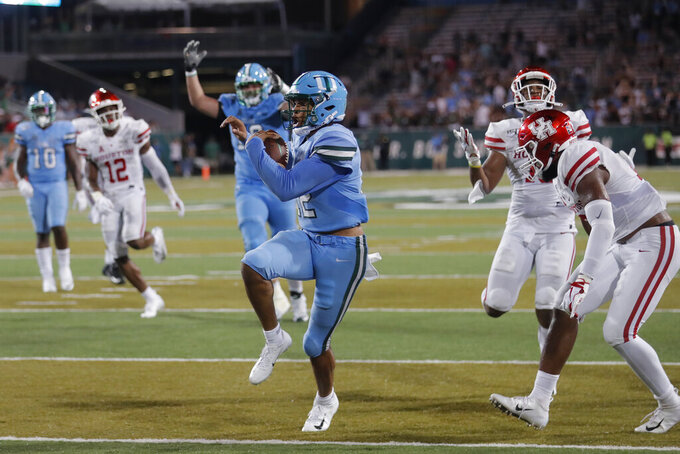 Tulane quarterback Justin McMillan (12) runs the ball in for a touchdown during the second half of the team's NCAA college football game against Houston in New Orleans, Thursday, Sept. 19, 2019. Tulane won 38-31. (AP Photo/Gerald Herbert)