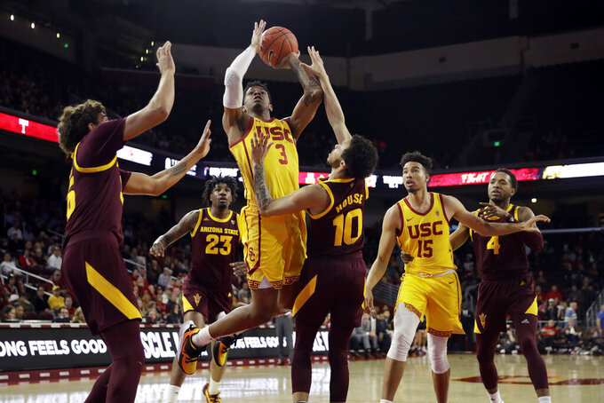 Southern California guard Elijah Weaver (3) shoots over Arizona State guard Jaelen House (10) during the first half of an NCAA college basketball game Saturday, Feb. 29, 2020, in Los Angeles. (AP Photo/Marcio Jose Sanchez)