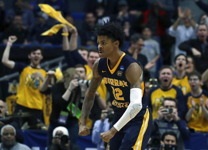 FILE - In this March 21, 2019, file photo, fans cheer as Murray State's Ja Morant (12) celebrates a basket during the second half of a first round men's college basketball game against Marquette in the NCAA Tournament, in Hartford, Conn. Morant was selected to The Associated Press All-America first team, Tuesday, April 2, 2019. (AP Photo/Elise Amendola, File)