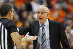 Syracuse head coach Jim Boeheim, right, yells at an official during the second half of an NCAA college basketball game against Virginia in Syracuse, N.Y., Wednesday, Nov. 6, 2019. Virginia won 48-34. (AP Photo/Nick Lisi)