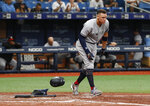 New York Yankees Aaron Judge heads out into the field after striking out against the Tampa Bay Rays during the fifth inning of a baseball game Sunday July 7, 2019, in St. Petersburg, Fla. (AP Photo/Scott Audette)