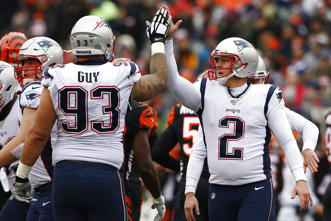 New England Patriots kicker Nick Folk (2) celebrates his field goal with defensive tackle Lawrence Guy (93) in the first half of an NFL football game, Sunday, Dec. 15, 2019, in Cincinnati. (AP Photo/Gary Landers)