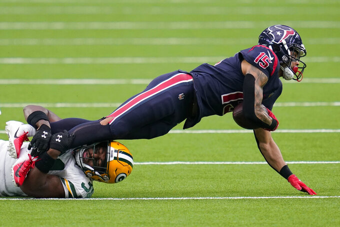 Houston Texans wide receiver Will Fuller V (15) struggles for yardage as Green Bay Packers safety Adrian Amos defends during the first half of an NFL football game Sunday, Oct. 25, 2020, in Houston. (AP Photo/Sam Craft)