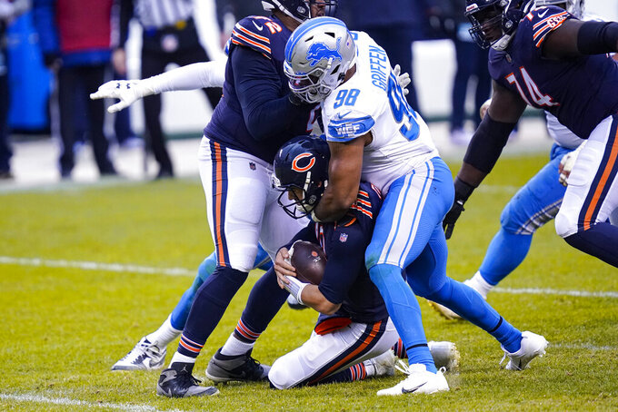 Chicago Bears quarterback Mitchell Trubisky (10) is sacked by Detroit Lions defensive end Everson Griffen (98) in the second half of an NFL football game in Chicago, Sunday, Dec. 6, 2020. (AP Photo/Charles Rex Arbogast)