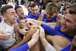 BYU players celebrate their victory over Utah State during an NCAA college basketball game Saturday, Dec. 14, 2019, in Salt Lake City. (AP Photo/Rick Bowmer)