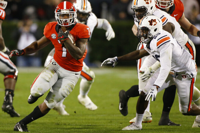 Georgia running back D'Andre Swift (7) moves the ball down the field during the first half of an NCAA college football game between Georgia and Auburn at in Athens Ga., Saturday, Nov. 10, 2018. (Joshua L. Jones/Athens Banner-Herald via AP)