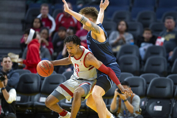 San Diego forward Yauhen Massalski (25) defends against Stanford guard Bryce Wills (2) during the first half of an NCAA college basketball game on Saturday, Dec. 21, 2019, in San Francisco. (AP Photo/D. Ross Cameron)