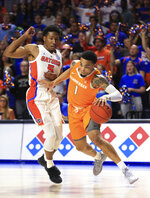 Tennessee guard Lamonte Turner (1) drives past Florida guard KeVaughn Allen (5) during the first half of an NCAA college basketball game Saturday, Jan. 12, 2019, in Gainesville, Fla. (AP Photo/Matt Stamey)