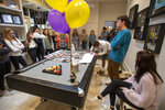 Classmates surround a table with photos of Walker Vincent during a 16th birthday party for Walker at Leslie Jacob's home on Sunday, December 29, 2019 in Lafayette, La. Walker Vincent was one of the victims in the plane crash on Saturday. Family and friends threw him a birthday party where they released LSU balloons and marked gifts with their favorite memories of Walker for his father.  (Brad Kemp/The Advocate via AP)