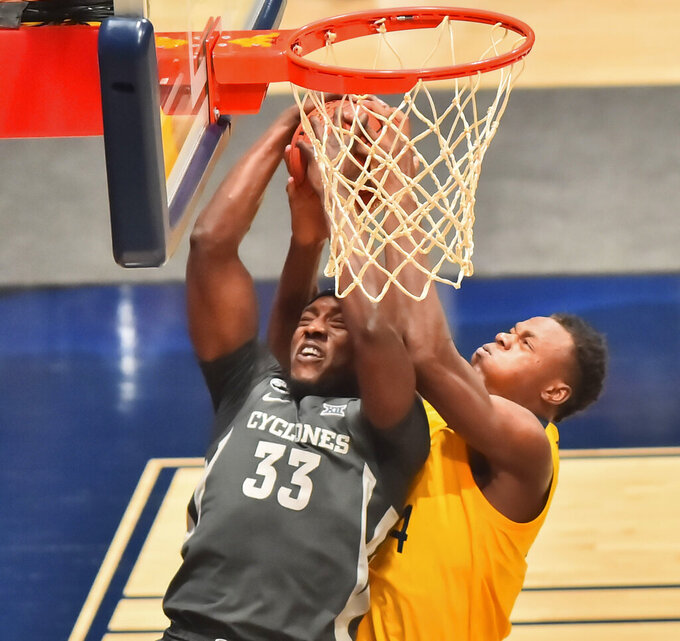 Iowa State forward Solomon Young (33) and West Virginia forward Oscar Tshiebwe (34) vie for a rebound during the second half of an NCAA college basketball game in Morgantown, W.V., Friday, Dec. 18, 2020. (William Wotring/The Dominion-Post via AP)