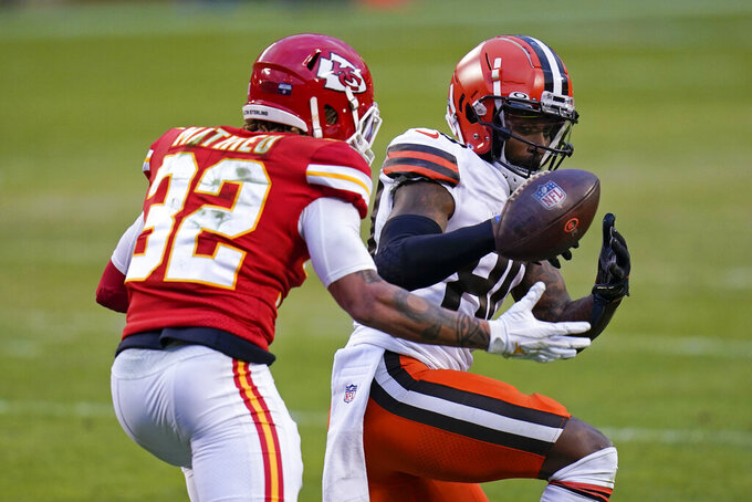 Kansas City Chiefs safety Tyrann Mathieu, left, breaks up a pass intended for Cleveland Browns wide receiver Jarvis Landry, right, during the second half of an NFL divisional round football game, Sunday, Jan. 17, 2021, in Kansas City. (AP Photo/Jeff Roberson)