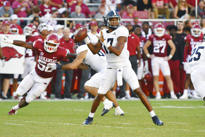 Georgia Southern quarterback Justin Tomlin (17) drops back to pass against Arkansas during the second half of an NCAA college football game Saturday, Sept. 18, 2021, in Fayetteville, Ark. (AP Photo/Michael Woods)