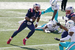 New England Patriots quarterback Cam Newton runs for a touchdown against the Miami Dolphins in the first half of an NFL football game, Sunday, Sept. 13, 2020, in Foxborough, Mass. (AP Photo/Steven Senne)