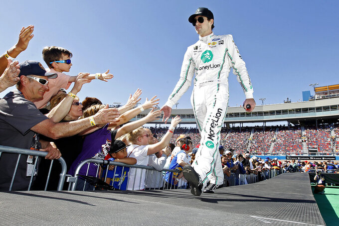 Pole sitter Ryan Blaney is greeted by fans during driver introductions prior to the start of the NASCAR Cup Series auto race at ISM Raceway, Sunday, March 10, 2019, in Avondale, Ariz. (AP Photo/Ralph Freso)