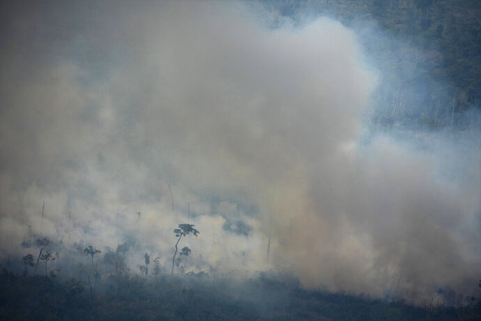 In this Friday, Aug. 23, 2019 photo, fire consumes an area near Porto Velho, Brazil. On Friday, The Associated Press reported on photos circulating online incorrectly asserting they show recent fires burning in the Amazon rainforest. Four of the most shared photos were published between 2009 and 2018. (AP Photo/Victor R. Caivano)