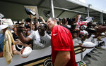 New Orleans Saints quarterback Drew Brees (9) poses for photos with fans at their NFL football training facility in Metairie, La., Friday, July 26, 2019. (AP Photo/Gerald Herbert)