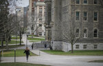 Students walk the campus on Syracuse University, Thursday, Nov. 21, 2019, in New York. Syracuse University students describe fear and anxiety as reports of racist graffiti and vandalism add up on campus. (AP Photo/Carolyn Thompson)