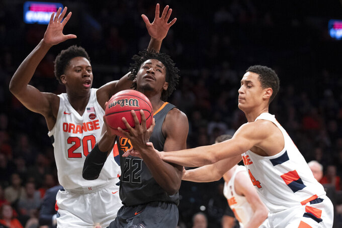 Syracuse forward Robert Braswell (20) and center Jesse Edwards (14) guard Oklahoma State forward Kalib Boone (22) during the first half of an NCAA college semi final basketball game in the NIT Season Tip-Off tournament, Wednesday, Nov. 27, 2019, in New York. (AP Photo/Mary Altaffer)