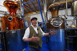 In this picture taken Sunday, Sept. 1, 2019, Dale McQueen speaks during an interview with The Associated Press in his distillery gin in Callander, north of Edinburgh, Scotland. McQueen says he hopes to be able to plow profits from his fast-growing business into a second referendum campaign. (AP Photo/Francois Mori)