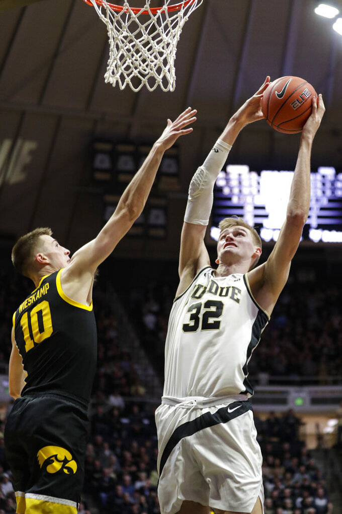 Purdue center Matt Haarms (32) shoots over Iowa guard Joe Wieskamp (10) during the second half of an NCAA college basketball game in West Lafayette, Ind., Wednesday, Feb. 5, 2020. Purdue defeated Iowa 104-68. (AP Photo/Michael Conroy)
