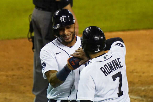 Detroit Tigers' Victor Reyes is greeted at home by teammate Austin Romine after they scored on a single by Jeimer Candelario during the fifth inning of the team's baseball game against the Milwaukee Brewers, Tuesday, Sept. 8, 2020, in Detroit. (AP Photo/Carlos Osorio)