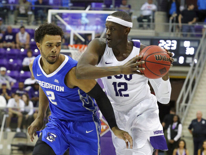 TCU forward Kouat Noi (12) drives against Creighton guard Connor Cashaw in an NCAA college basketball game in Fort Worth, Texas, Tuesday, March 26, 2019. (Richard W. Rodriguez/Star-Telegram via AP)