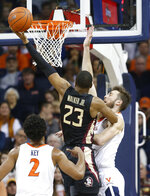 Florida State guard M.J. Walker (23) takes a shot over Virginia forward Jay Huff (30) during the first half of an NCAA college basketball game in Charlottesville, Va., Saturday, Jan. 5, 2019. (AP Photo/Steve Helber)