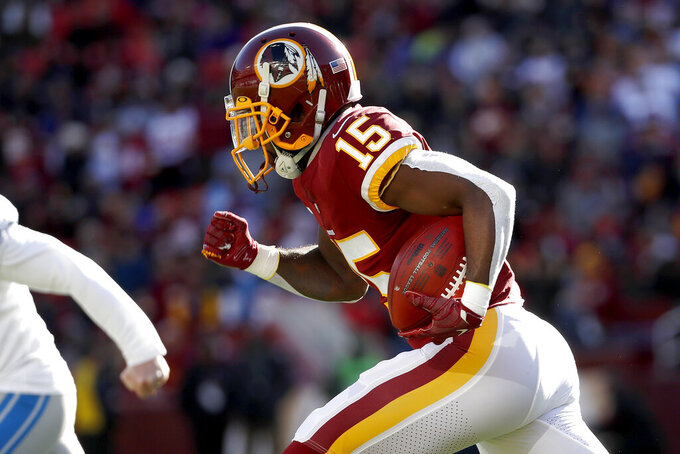 Washington Redskins' Steven Sims returns a kickoff from the Detroit Lions for a touchdown during the first half of an NFL football game, Sunday, Nov. 24, 2019, in Landover, Md. (AP Photo/Alex Brandon)