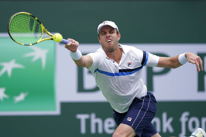 Sam Querrey returns a shot to Daniel Altmaier, of Germany, at the BNP Paribas Open tennis tournament Thursday, Oct. 7, 2021, in Indian Wells, Calif. (AP Photo/Mark J. Terrill)