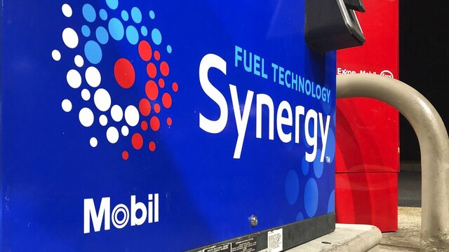 In this Jan. 28, 2020, photo a Mobil sign is affixed to an Exxon Mobil fuel pump in Marlborough, Mass. Exxon Mobil Corp. reports financial results Friday, Jan. 31. (AP Photo/Bill Sikes)