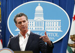 Gov. Gavin Newsom announces that California will spend $20 million on a public awareness campaign about the dangers of vaping nicotine and cannabis products amid a rise in vaping-related illnesses, during a news conference in Sacramento, Calif., Monday, Sept. 16, 2019. (AP Photo/Rich Pedroncelli)