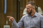 Nathan Smith gestures as he makes a victim impact statement during the sentencing hearing for Australian Brenton Harrison Tarrant at the Christchurch High Court after Tarrant pleaded guilty to 51 counts of murder, 40 counts of attempted murder and one count of terrorism in Christchurch, New Zealand, Tuesday, Aug. 25, 2020. More than 60 survivors and family members will confront the New Zealand mosque gunman this week when he appears in court to be sentenced for his crimes in the worst atrocity in the nation's modern history. (John Kirk-Anderson/Pool Photo via AP)
