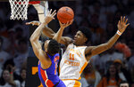 Tennessee forward Kyle Alexander (11) attempts to block the shot of Florida forward Keyontae Johnson (11) during the first half of an NCAA college basketball game, Saturday, Feb. 9, 2019, in Knoxville, Tenn. (AP photo/Wade Payne)