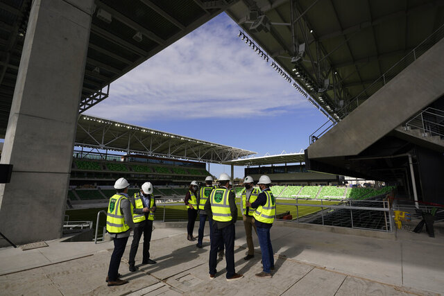 Dignitaries gather for a ribbon cutting at Austin FC's new stadium under construction which has been named Q2 Stadium, Monday, Jan. 25, 2021, in Austin, Texas. (AP Photo/Eric Gay)