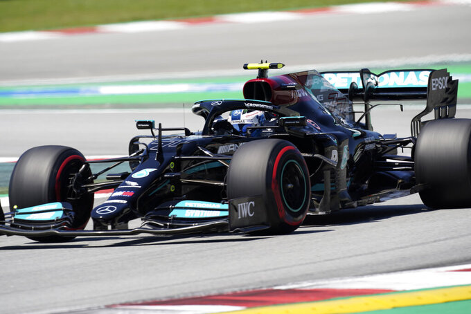 Mercedes driver Valtteri Bottas of Finland steers his car during the third free practice for the Spanish Formula One Grand Prix at the Barcelona Catalunya racetrack in Montmelo, just outside Barcelona, Spain, Saturday, May 8, 2021. The Spanish Grand Prix will be held on Sunday. (AP Photo/Emilio Morenatti)