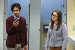 This image released by CBS shows Kunal Nayyar, left, and Mayim Bialik in a scene from the series finale of