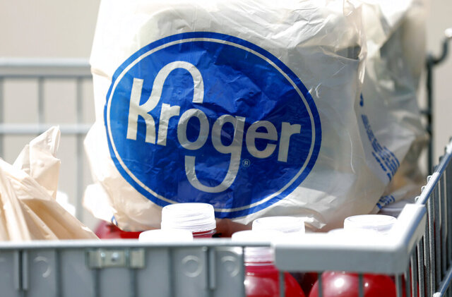 FILE- In this June 15, 2017, file photo bagged purchases from a Kroger grocery store sit in a shopping cart in Flowood, Miss. Kroger's sales surged in the third quarter, continuing to benefit from people stocking up on groceries as they stay home amid the pandemic. The grocery chain boosted its full-year outlook, partly on the expectation that trends in at home food consumption will continue for the rest of its fiscal year. (AP Photo/Rogelio V. Solis, File)