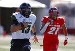 Hawaii quarterback Cole McDonald (13) sprints to the end zone for a touchdown followed by New Mexico safety Brandon Burton (21) during the first half of an NCAA college football game on Saturday, Oct. 26, 2019, in Albuquerque, N.M. (AP Photo/Andres Leighton)