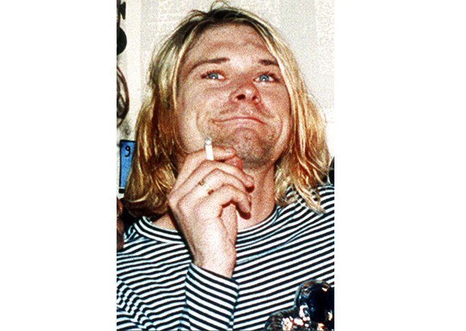 FILE - This 1993 file photo shows Kurt Cobain, the lead singer of the U.S. rock band Nirvana. Six strands of blonde hair from the grunge rock icon are part of a series of Nirvana offerings that also includes a Cobain amp and a rare group-signed blue Stratocaster-style guitar at an online rock 'n' roll auction that ends over the weekend..  (AP Photo/Mark J. Terrill, File)