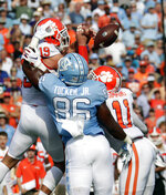 Clemson's Tanner Muse (19) and Isaiah Simmons (11) break up a pass intended for North Carolina's Carl Tucker (86) during the first quarter of an NCAA college football game against North Carolina in Chapel Hill, N.C., Saturday, Sept. 28, 2019. (AP Photo/Chris Seward)
