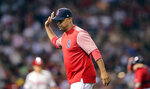 Boston Red Sox manager Alex Cora gestures after unsuccessfully arguing with umpires about a call during the fourth inning of the team's baseball game against the Philadelphia Phillies at Fenway Park in Boston, Tuesday, Aug. 20, 2019. (AP Photo/Charles Krupa)