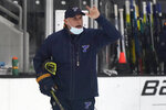 St. Louis Blues head coach Craig Berube instructs his team during NHL hockey training camp Tuesday, Jan. 5, 2021, in Maryland Heights, Mo. (AP Photo/Jeff Roberson)
