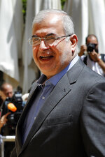 In this May 23, 2018 photo, Muhammad Hasan Ra'd, the head of the Hezbollah lawmakers bloc, enters parliament for the election of the house speaker in Beirut, Lebanon.  The U.S. Treasury Department is imposing sanctions Lebanon Parliament members Amin Sherri and Muhammad Hasan Ra'd, and Hezbollah official Wafiq Safa, who are suspected of using their positions to further the aims of the Iran-backed military group and
