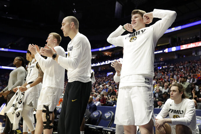 Players on the Missouri bench celebrate after a score against Georgia in the second half of an NCAA college basketball game at the Southeastern Conference tournament, Wednesday, March 13, 2019, in Nashville, Tenn. Missouri won 71-61. (AP Photo/Mark Humphrey)