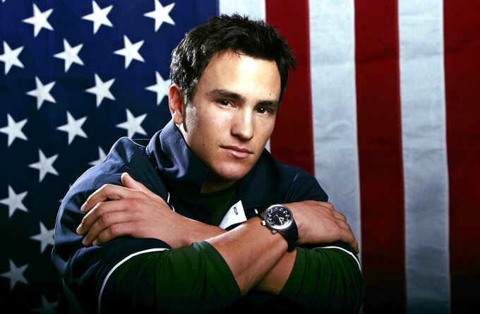 """FILE - US Olympic freestyle moguls skier Jeremy Bloom poses for a portrait on Oct. 11, 2005, in Colorado Springs, Colo. Olympians including Michael Phelps, Apolo Ohno and Bloom are opening up about their mental health struggles in a new sobering documentary about suicide and depression among the world's greatest athletes. Many of the athletes are sharing their pain for the first time in HBO's """"The Weight of Gold,"""" which aims to expose the problem, incite change among Olympics leadership and help others experiencing similar issues feel less alone. (AP Photo/Ed Andrieski, File)"""